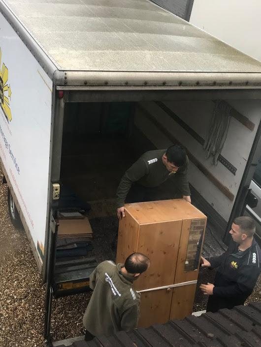 Image 18 - Loading the van