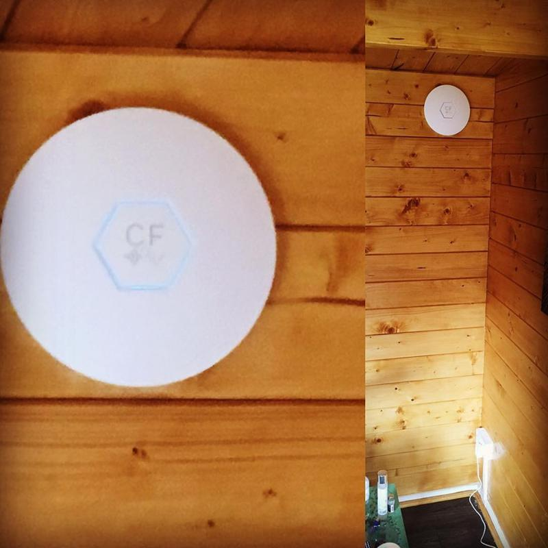 Image 1 - Wired Access point installation in wooden lodge building. Customer had no WiFi signal but now has full strength. Spreads nicely into the garden area too.