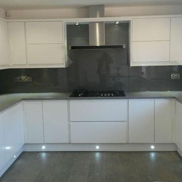 Image 18 - Supplied and this beautiful kitchen in derby. Complete with handle less doors. Granite worktops and grey glass splash backs