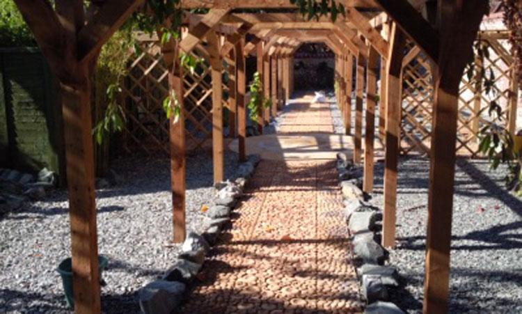 Image 2 - the pergola with a sun circle in walsingham
