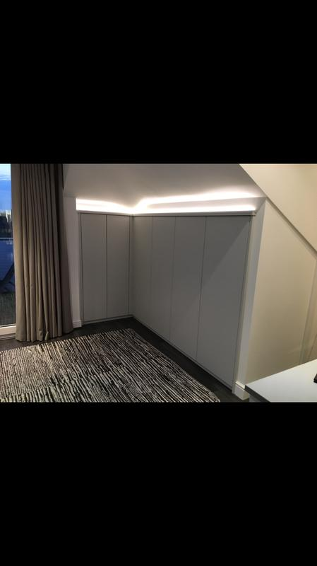 Image 7 - Bespoke wardrobe built beneath awkward ceiling pitch. With dimmable pelmet lighting .