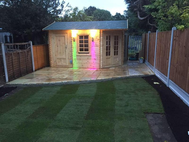 Image 32 - On this project we installed a log cabin, Indian sandstone, new fencing and then re-turfed the lawn.
