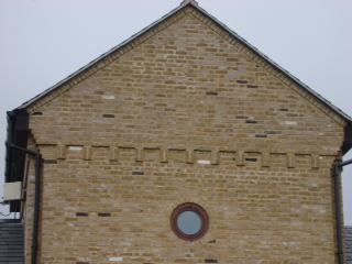 Image 6 - Complete new gable end built by us including feature Brickwork , Bullseye window, dental coursing, & projection courses Feltmores Farm