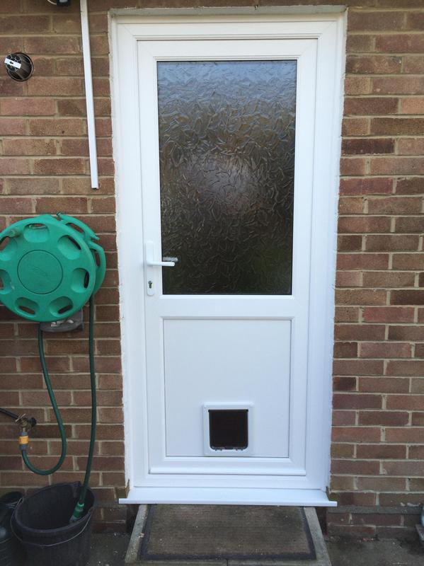 Image 99 - White UPVC Door with Toughened safety glass and re-inforced panel as standard