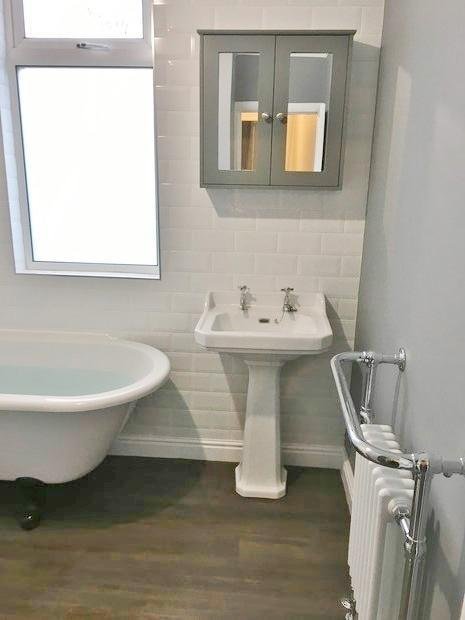 Image 37 - Wash hand basin and full pedestal, completing the traditional style bathroom. Wooden flooring requested by the customer
