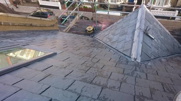 Image 12 - London Natural spanish slate and parapet wall render and coping stone renewal.