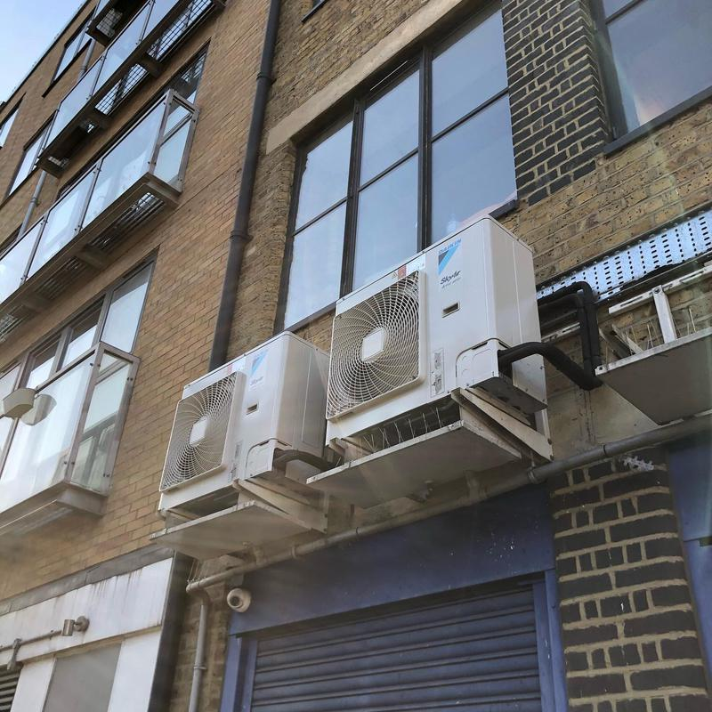 Image 20 - Daikin condensers hung at high level with drip trays installed