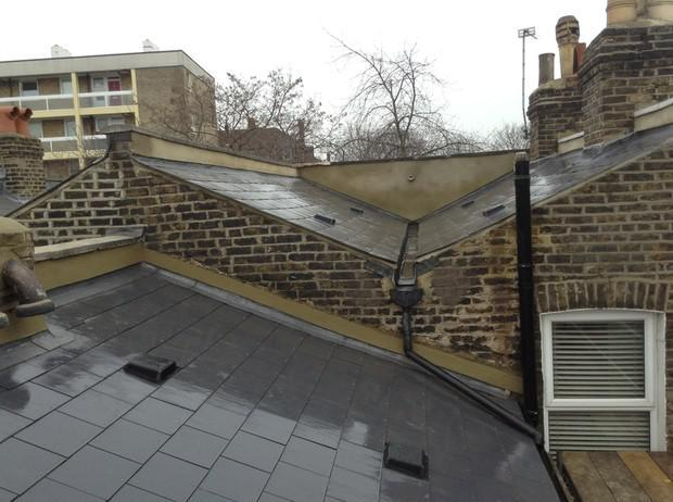 Image 24 - Brockley Marley Eternit thrutone immitaion slate and parapetwall render and coping stone renewal.
