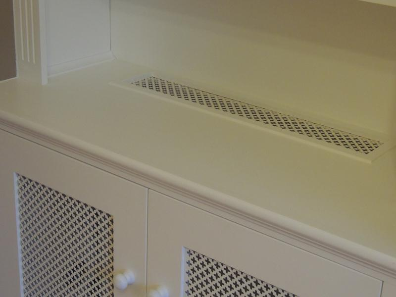 Image 23 - A decorative grille has been fitted within this cupboard as it houses a rad