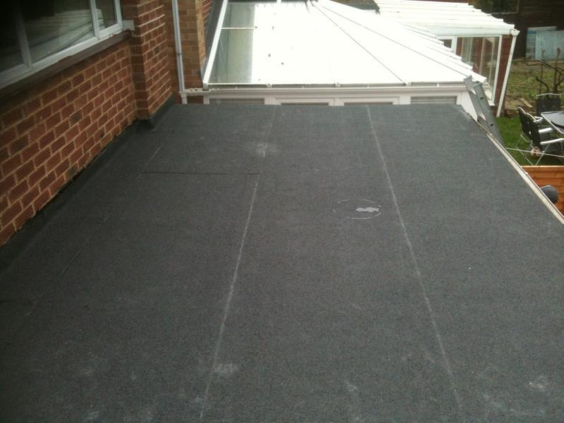Image 6 - Extension flat roof, showing the final 3rd layer of torch on felt.
