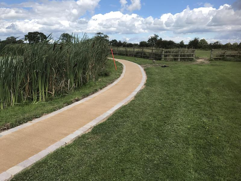 Image 15 - A beautiful curved footpath with resin around a pond,