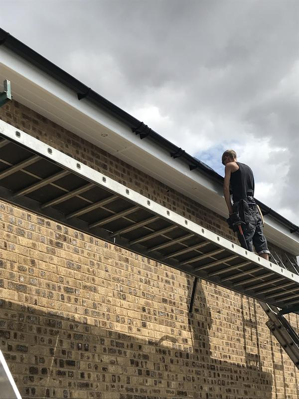 Image 5 - Vented soffit with black round guttering