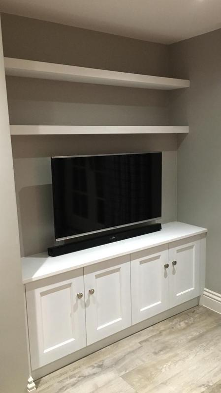 Image 1 - Bespoke media cabinet incorporating false wall behind tv to allow wires to pass unseen into base cabinets. Including floating shelves.