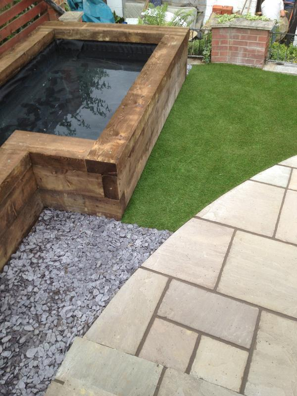 Image 8 - Indian Sandstone Patio, Sleeper Pond and a small area of artificial lawn