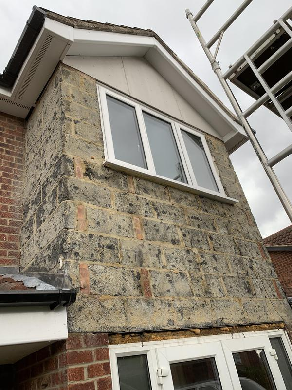 Image 42 - A 1980s mock Tudor frontage striped back to block work.