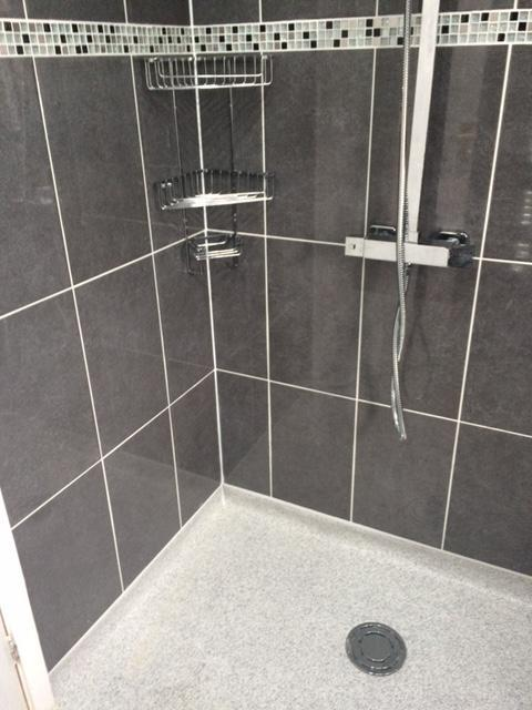 Image 7 - Wet floor shower room, full tiling with border tiles, thermostic mixer shower with fixed shower head, anti slip flooring and accessories.