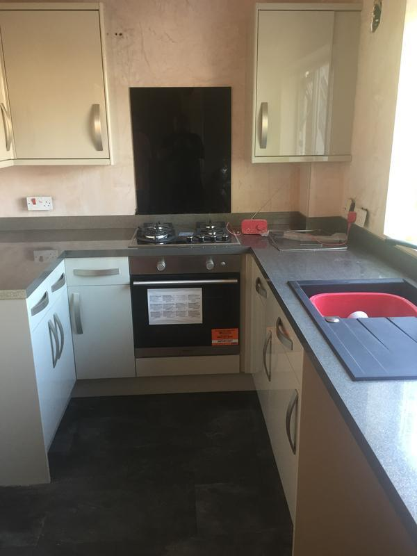 Image 6 - A high gloss kitchen in the finishing stages