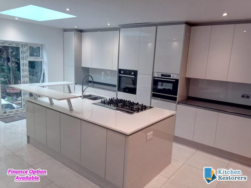 Image 18 - Modern Full Kitchen Fitted in an Extension, True Handle-less UnitsDoor Colour: Acrylic High Gloss White with High Gloss Light Grey Panels/PlinthsWorktop Colour: Solid Surface Worktops (Glacier Island and Zenith)
