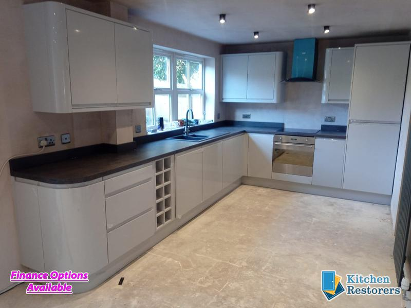 Image 12 - Built in J Profile Handle Full Kitchen in a new ExtensionDoors: High Gloss Light Grey J ProfileWorktop: Laminate Bronze Chromix