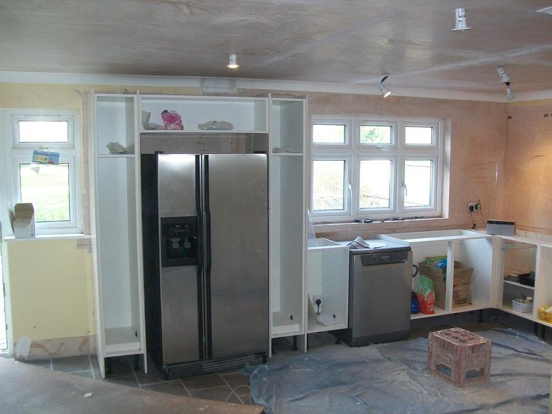 Image 2 - Kitchen being fitted with plumbing and electrical work covered