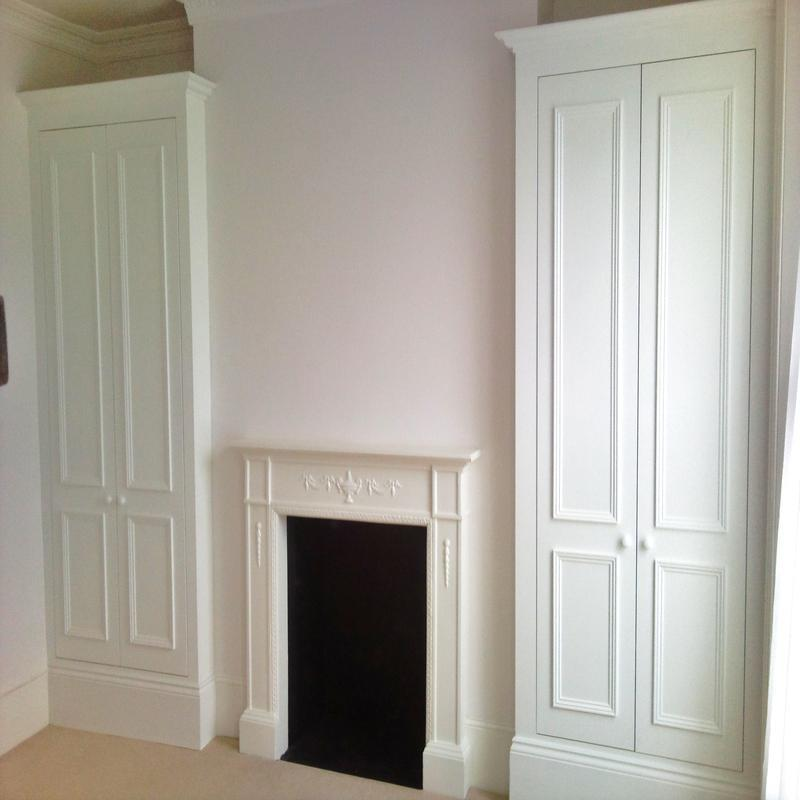 Image 11 - Fitted alcove wardrobes with a moulding fitted to the doors.