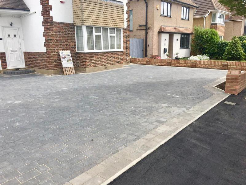 Image 13 - Double block paved driveway using Marshalls Drivesett Savanna in charcoal with a pennant grey border