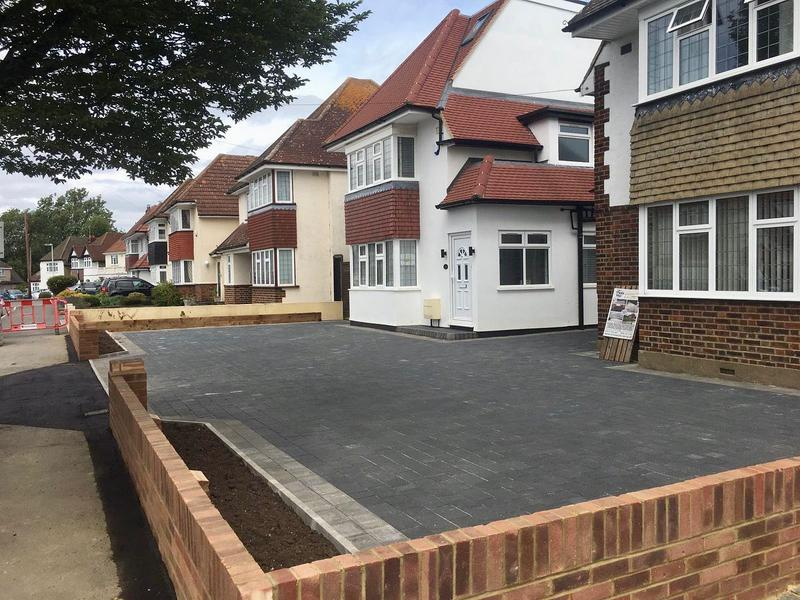 Image 12 - Double block paved driveway using Marshalls Drivesett Savanna in charcoal with a pennant grey border