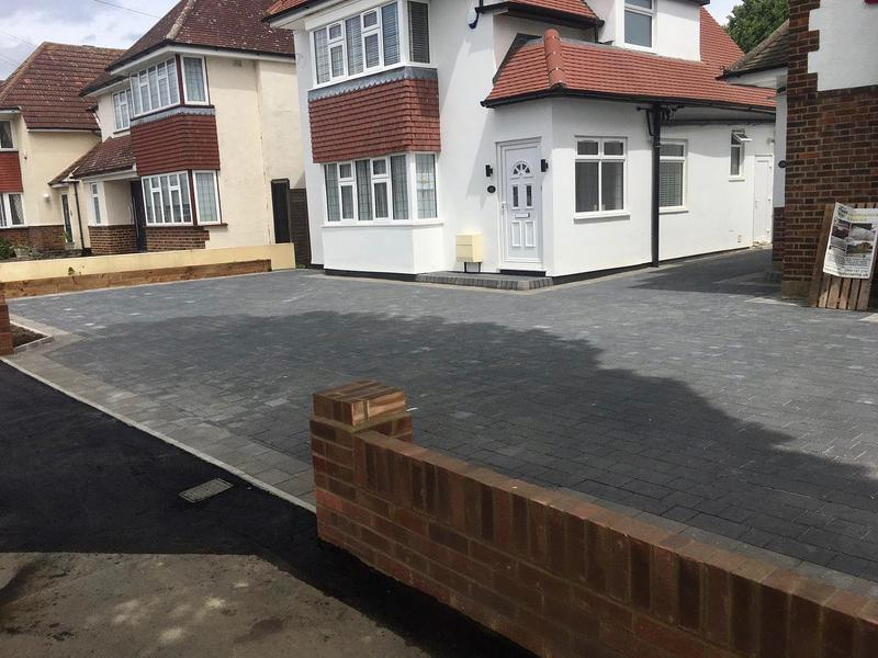 Image 12 - Double block paved driveway using Marshalls Drivesett Savanna in charcoal with a pennant grey border, brick walls with end pillars