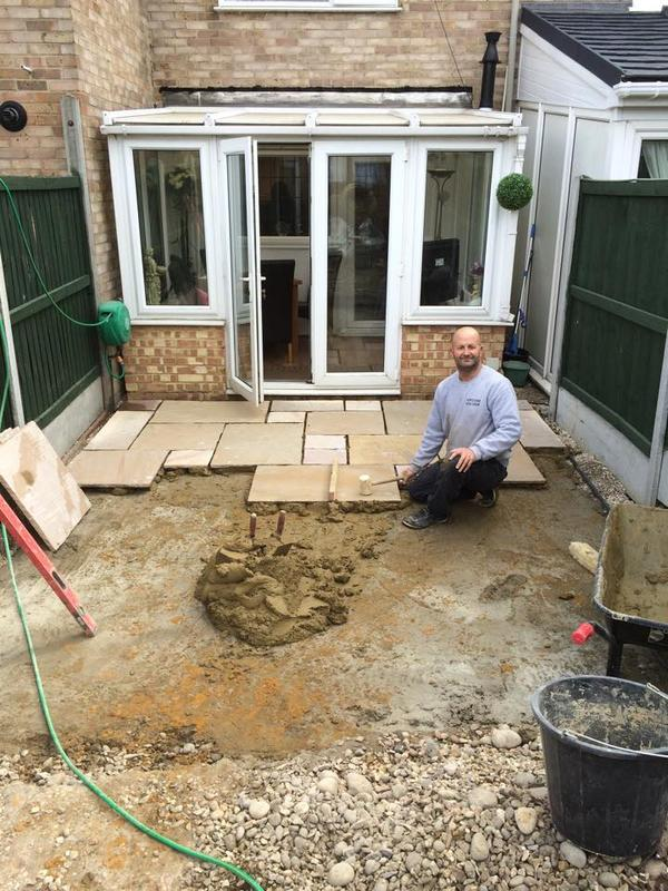 Image 30 - A start to laying indian sandstone patio on full mortar bed in welling kent