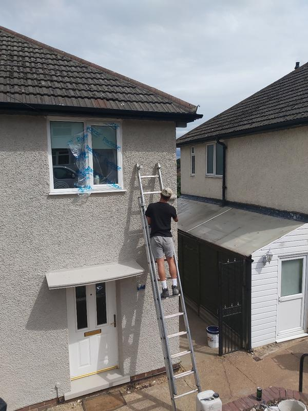 Image 2 - A colour coating being applied. This protects the property from penetrating damp as well giving it a brand new look.