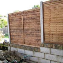 "Image 12 - retaining 9"" block wall with integrated fence posts & fence panels"