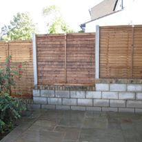 "Image 13 - retaining 9"" block wall with integrated fence posts & fence panels"