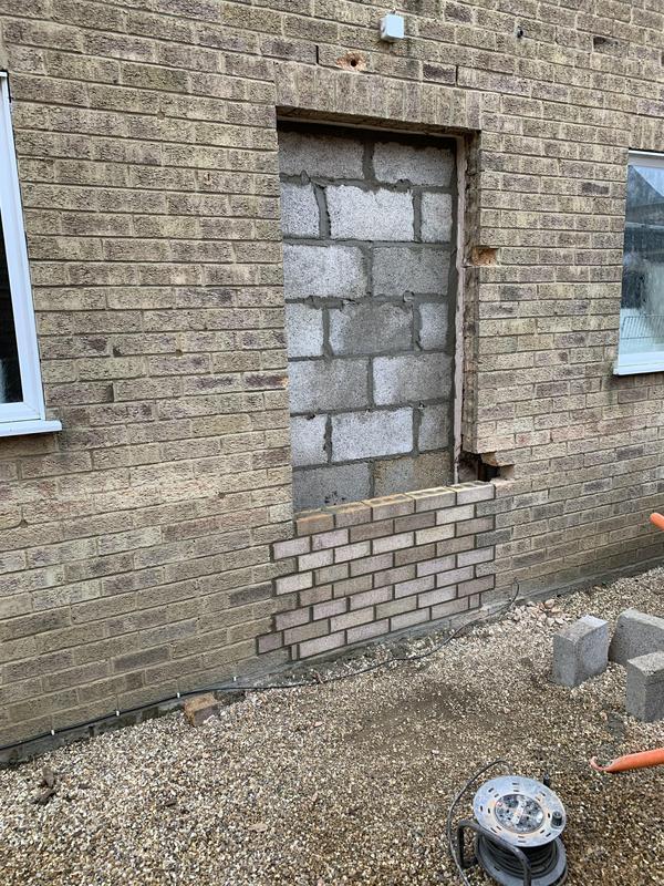 Image 25 - Bricking up unwanted side door in progress.