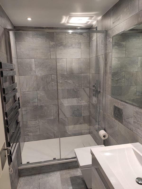 Image 6 - RELM Interiors completely renovated a shower room in Putney. The whole shower room was stripped. New flooring, underfloor heating, wall tiles, plumbing and all bathroom accessories were newly installed, the outcome was a stunning modern up to date bathroom.