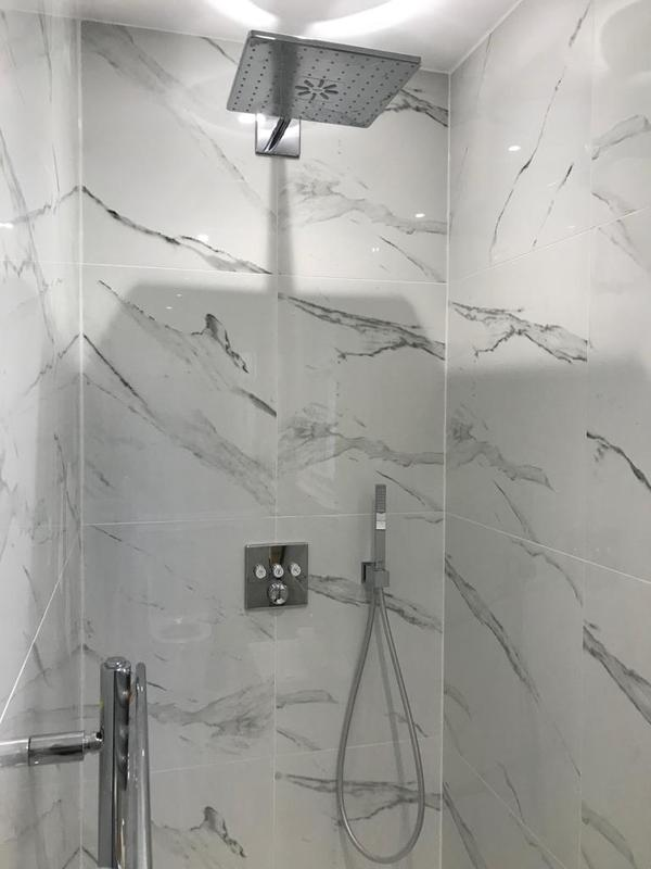 Image 21 - Complete renovation of a second bathroom using marble tiling for the floor and walls. Complete with fixtures and fittings.
