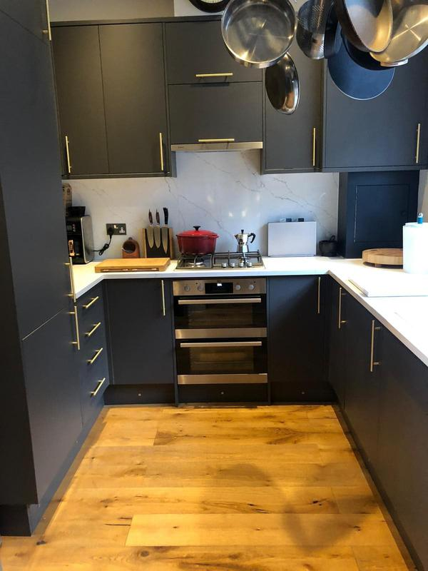 Image 26 - Small, compact kitchen install. Finished with marble worktops & splashbacks