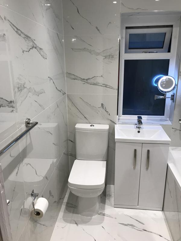 Image 20 - Complete refurbishment of a bathroom was done in Romford. Completely rebuilt, Plumbing and fixtures re done. Marble flooring and tiling throughout the entire bathroom.
