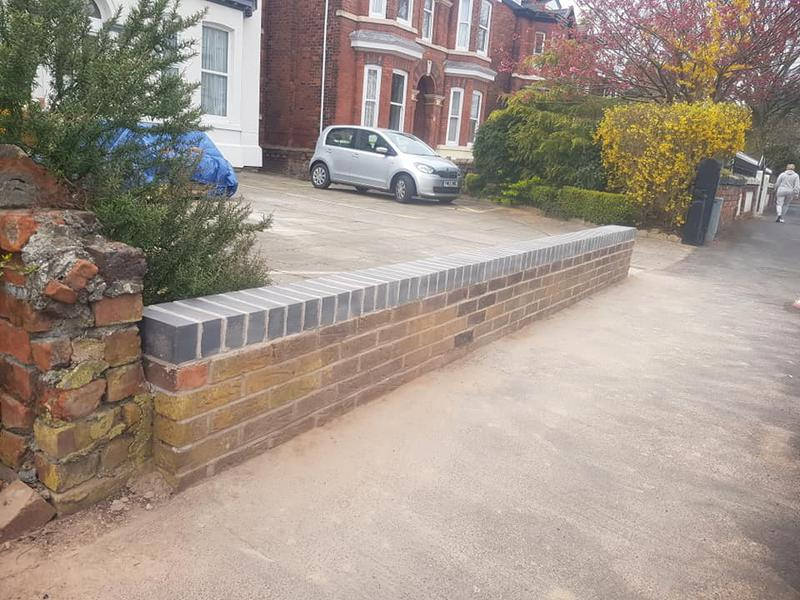 Image 6 - Partial de-construction of wall and rebuilding