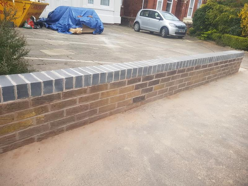 Image 5 - Partial de-construction of wall and rebuilding