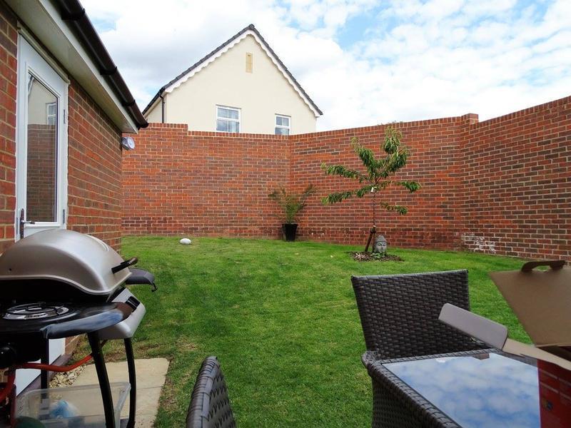 Image 20 - Before - sloped new build garden