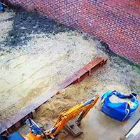 Image 22 - works begin to flatten existing lawn using existing garden materials tp fill and railway sleepers to level