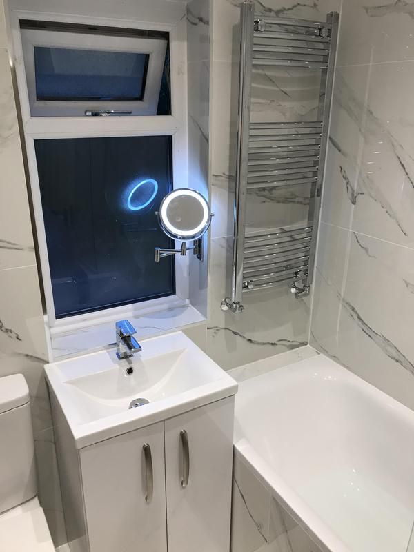 Image 19 - Complete refurbishment of a bathroom was done in Romford. Completely rebuilt, Plumbing and fixtures re done. Marble flooring and tiling throughout the entire bathroom.