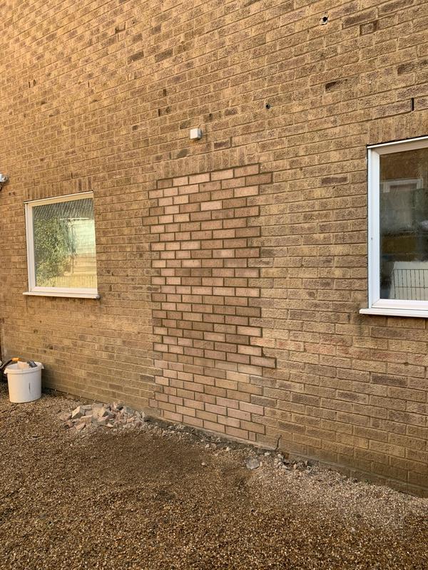 Image 26 - Bricking up unwanted side door.