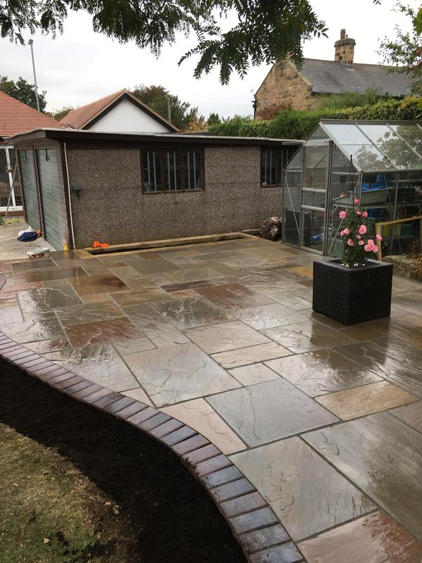 Image 34 - Indian sandstone paving with black border