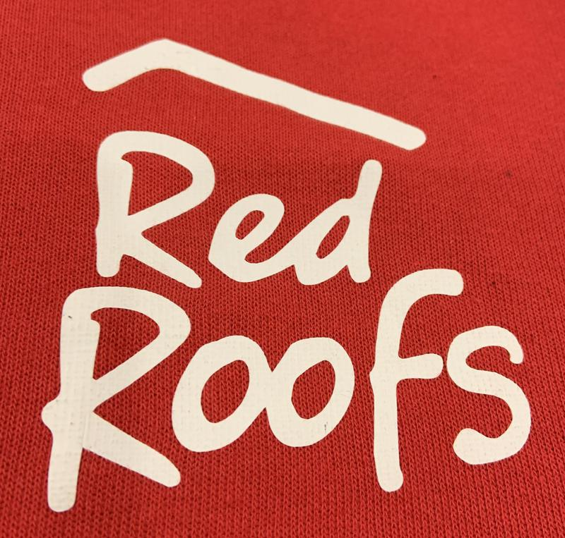 Red Roofs logo