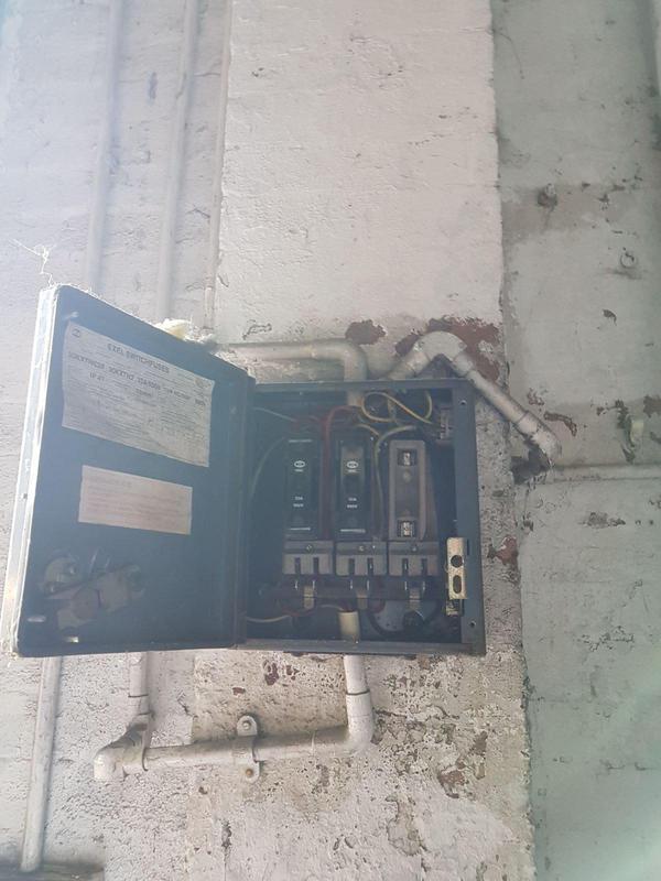 Image 6 - Asbestos Fuse Box Flash Guard Removal - DURING