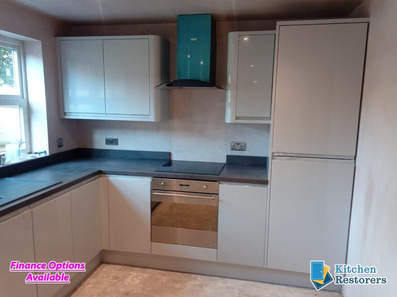 Image 13 - Built in J Profile Handle Full Kitchen in a new ExtensionDoors: High Gloss Light Grey J ProfileWorktop: Laminate Bronze Chromix
