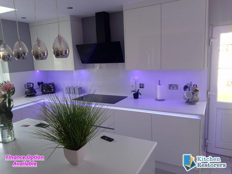 Image 2 - Full True Handle-less Kitchen FittedDoor Colour: Acrylic High Gloss WhiteWorktop: Solid Surface Peak