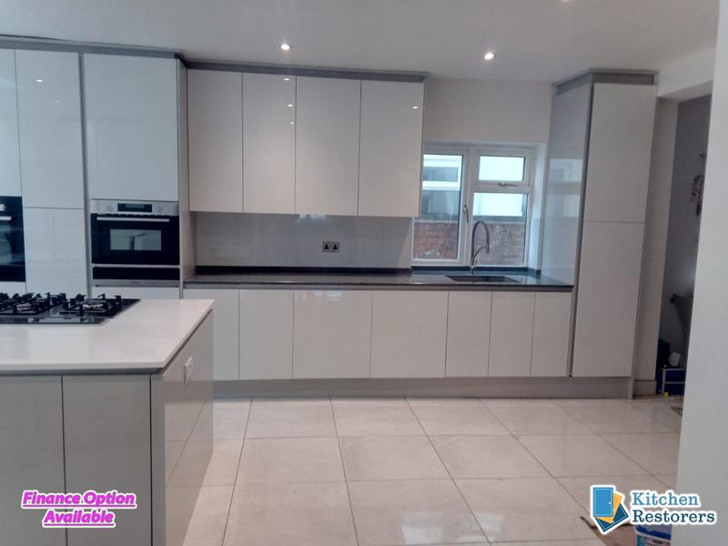 Image 19 - Modern Full Kitchen Fitted in an Extension, True Handle-less UnitsDoor Colour: Acrylic High Gloss White with High Gloss Light Grey Panels/PlinthsWorktop Colour: Solid Surface Worktops (Glacier Island and Zenith)