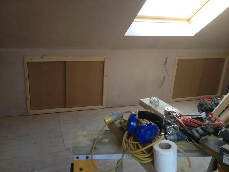 Image 9 - attic work 2nd fix stage4 skimming work,and applying MDF sliding doors for an easy access to the storage